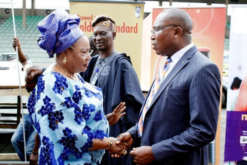 Corporate Affairs Manager- West Nigerian Breweries Plc, Mr. Tayo Adelaja in a handshake with Mrs. Bisi Oshibogun, a member of the Ojude Oba organizing committee at a press conference in Ijebu Ode to announce Goldberg and Maltina as sponsors