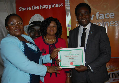 (L-R) Member, Nutrition Society of Nigeria (NSN) Professor Lilian Salami, President, Dr. Ngozi Nnam and the Senior Brand Manager Maltina, Mr. Adewole Adedeji at the Nutrition Society of Nigeria Presentation of Endorsement Certificate to Maltina during the opening session of the 45th annual general meeting and scientific conference 2015