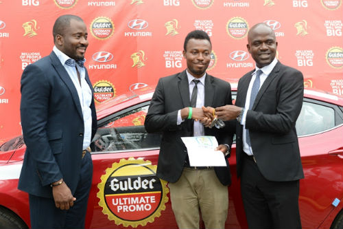 Desmond Elliot, Emmanuel Agu Marketing Manager, Gulder, More, 33, Life and Stout category, both of Nigerian Breweries Plc during the prize presentation for raffle draw winners in the ongoing Gulder Ultimate Promo at NB headquarters in Lagos presenting the keys to a brand new Hyundai Elantra to Chibueze Gift Chukwuoti, winner of the Gulder Ultimate Promo via a raffle draw recently held in Port Harcourt