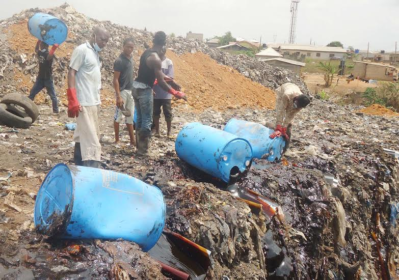 Expired Malt extracts and Glucose belonging to Guinness Nigeria Plc being destroyed at a dump site in Otta, Ogun State on Thursday, 10th March, 2016