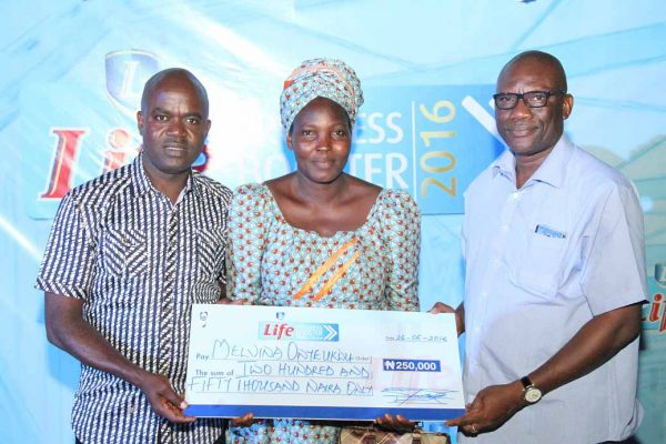 L-R Emmanuel Agu, Portfolio Manager, Mainstream Lager and Stout Brands NB Plc, Winner of Progress Booster and Obiora Okolo, Regional Business Manager, Enugu