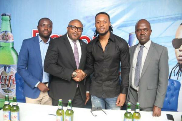 Funso Ayeni, Senior Brand Manager, Regional Mainstream, Nigerian Breweries Plc; Kufre Ekanem, Corporate Affairs Adviser, Nigerian Breweries Plc; Brand Ambassador, Flavour N'abania; Emmanuel Agu, Portfolio, Manager, Mainstream Stout, Nigerian Breweries Plc, during the signing ceremony of the ambassadorial deal
