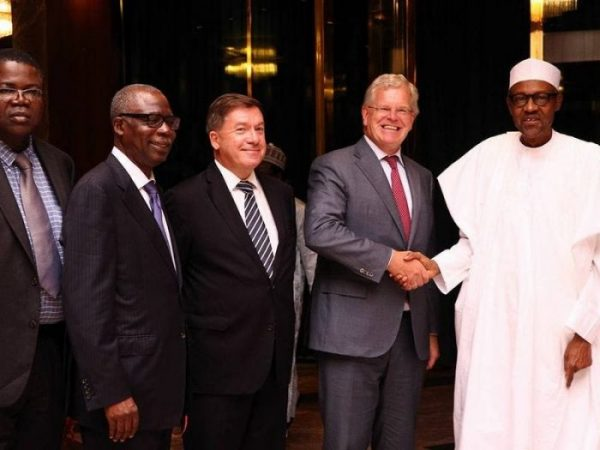 President Buhari shaking hands with Global CEO of FrieslandCampina, Roelof Joosten at State House, Abuja on Tuesday