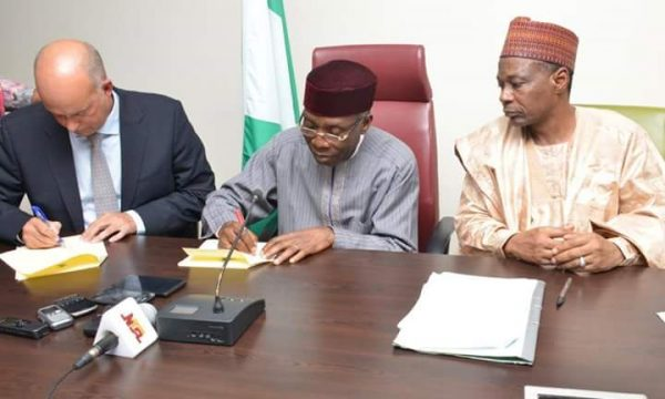 Minister of Agriculture and rural development, Chief Audu Ogbe signing an MoU with Steen Hadsbjerg, from Arla Foods