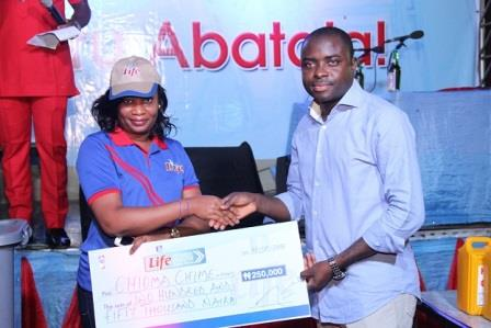 L-R Chioma Chime, a winner from Life Continental Beers Progess Booster Show with the Senior Brand Manager, Regional Mainstream, Nigerian Breweries Plc, Mr. Funso Ayeni in Owerri