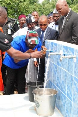 Executive Governor of Benue State, Dr. Samuel Ortom drinking water as Managing Director, Guinness Nigeria, Peter Ndegwa looks on the commissioning ceremony of a water project donated by Guinness Nigeria to the Tyowanye community in Benue state