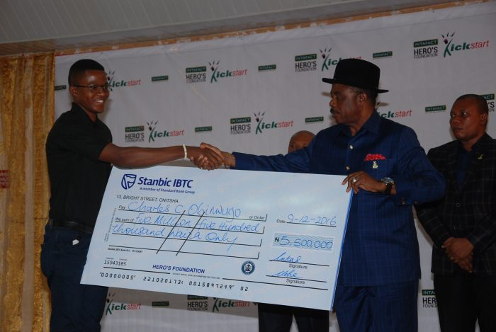 Charles Obinwugo star winner with the Governor of Anambra State His Excellency Chief Willie Obiano at the presentation of his cheque at the Award Ceremony of Intafact Hero's Foundation Kickstart Programme which took place at DollyHills Hotel, Onitsha on Friday, December 9, 2016.