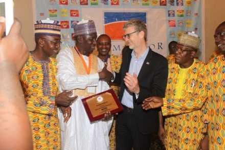 Alhaji Muhammed Abdul Kadri receiving the number One Man Award from the Managing Director, Promasidor Nigeria Limited, Mr Olivier Thiry