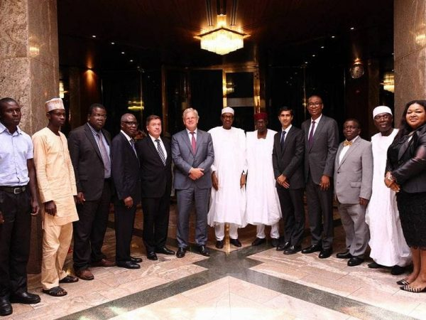 President Buhari with Chief of Staff Abba Kyari, takes a group photo with Friesland Campina Global CEO, Mr Roelof Joostenand his delegation at the Statehouse on 9th August 2016