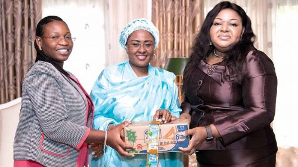 Nigeria's First Lady, Mrs. Aisha Buhari (middle) receiving Corporate Affairs Director, FrieslandCampina WAMCO, Mrs. Ore Famurewa (right) and Public Affairs Manager, Mrs. Temitope Adeola (left) in Aso Rock for the company's support of her 'Get Involved' campaign with a donation of 5000 cartons of Peak Milk sachets for internally displaced persons (IDPs) in northeast Nigeria